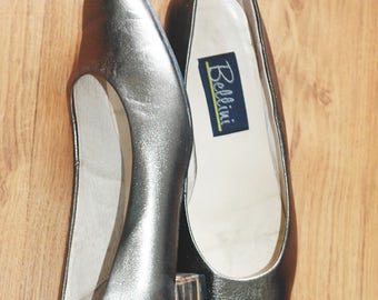 80s silver shiny shoes with gold stripes on heels