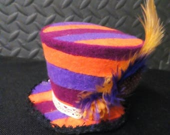 Orange, purple and maroon mini top hat