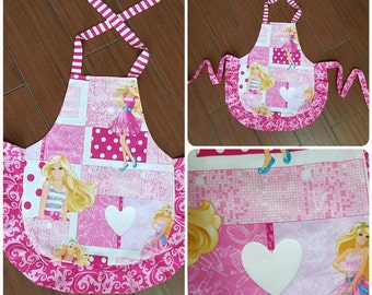 3 or 4 year old mini child apron. Barbie print with pink frills and ties. HEAT PRESS white heart.