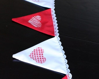 Garland of flags for Valentine's day with motifs of hearts hand painted