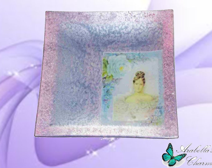 Plate tray of glass decorated in retro style with brilliant rough clay of color pink and lilac wisteria
