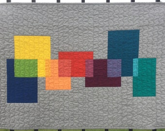 "Contemporary quilted wall hanging. Modern abstract fabric textile art. Gray/teal/blue/yellow/green/violet/orange/ aqua 34.5"" x 23.5"""