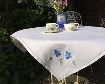 Vintage white linen tablecloth, cornflower blue embroidered flowers 1950s