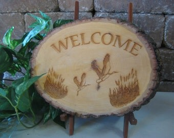 Wooden Barked Oval Engraved with Welcome & Cranes