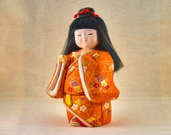 Kabuki Dancer. Girl with Traditional orange and gold Kimono. Gofun, Vintage, Japanese doll.