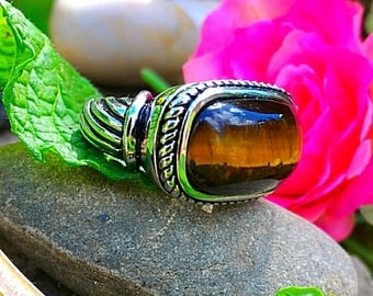 Ring size 7 and 8 US genuine Tiger's eye, protective shield that will return energy to its issuer