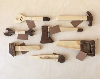 Wooden toys set builder. Tools are stored in a wooden box.