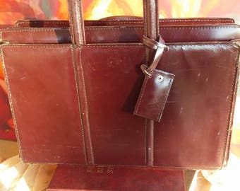 Leather attache case with pockets and sections