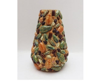 A stoneware vase with high relief bugs and beetles