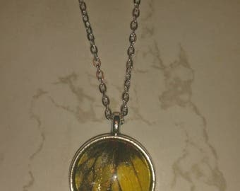 Round yellow and black wing necklace