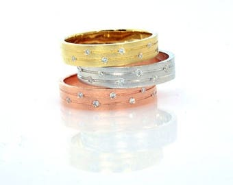 Solid 14k gold wedding band with 6 diamonds available in white yellow or rose gold