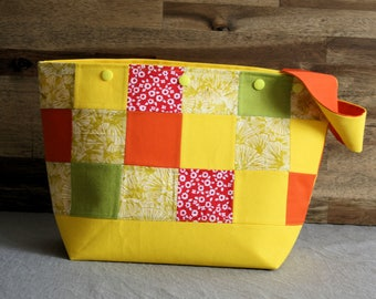 Yellow-green-orange project bag with patchwork panels and snap buttons