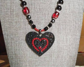 Red and Black Heart necklace.