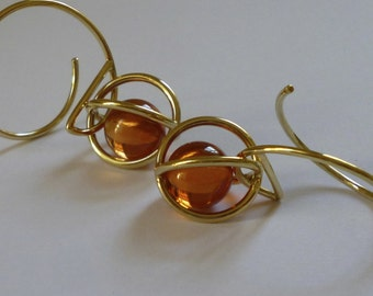 """Earrings """"Cage"""" 750 yellow gold with syn. Padparadscha balls"""