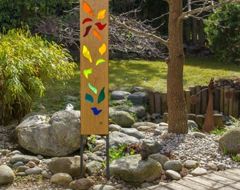 garden sculpture of wood and glass