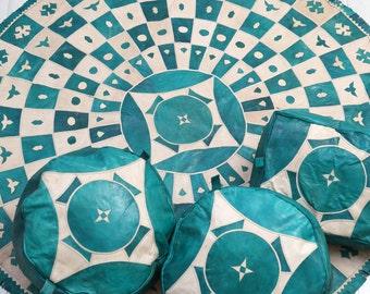 Set of carpet and tuareg skin pouf