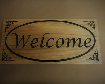 Custom carved wood welcome sign