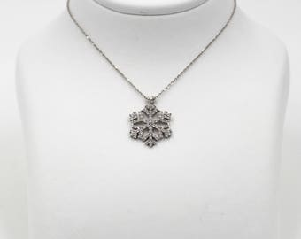 14k White gold Snow Flake necklace with white sapphires