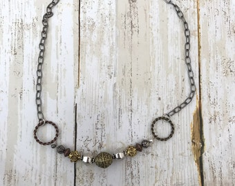 Metallic clasp necklace with unique beads