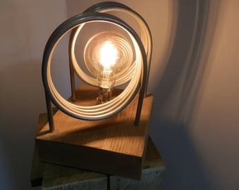 Beautiful Table Lamp Made from Dairy Equipment and mounted On A Reclaimed Wood Plinth   Looks Good From Any Angle