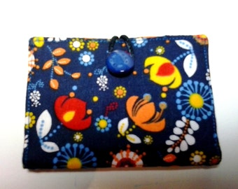 Business credit and visit card holder. Fabric flowers with blue background