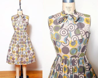 Vintage 50s swing dress / Atomic print dress / Pleated ascot dress / Fit and flare dress