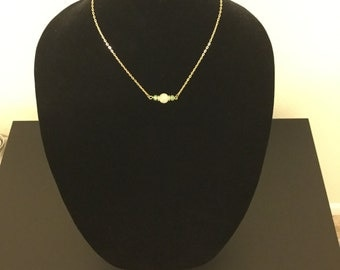 Simple white and gold necklace with turquoise accent