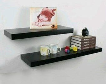 Chunky floating shelf black gloss.