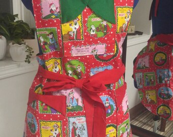 Maxine's Christmas apron, for the grouch in all of us.  Three pockets and reversible to green.  Can go from small to extra large.