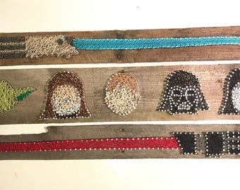 Star Wars characters and lightsaber string art wall decor