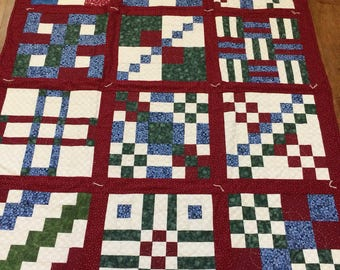 Sampler quilt from 1990's / machine pieced /  hand quilted / hand tied / lap quilt / twin size bed coverlet / reversible