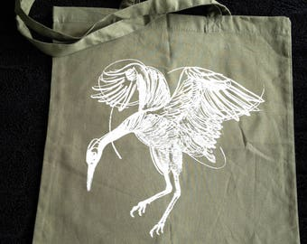 Hand printed by SUSYRTATTOO. One of a kind dancing crane tattoo design on 100% cotton olive green tote bag, Size: 38x42 cm