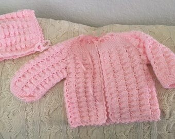 Hand crocheted baby sweater and cap