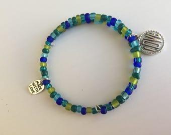 Beaded charm 'Love' bracelet