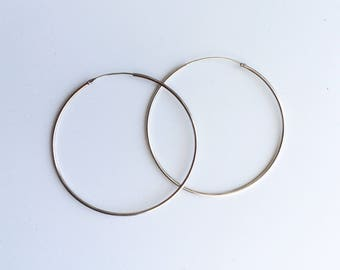 Thin silver hoops