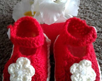 Beautiful red handmade shoes for little girls.