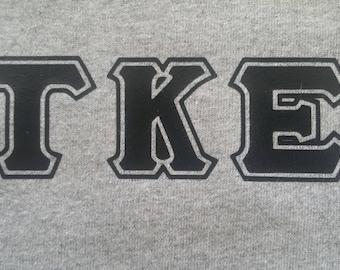 "15% Off Sale -- T-Shirt ""Tau Kappa Epsilon"" with Black Letters (Left Chest) -- MEDIUM"