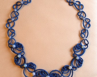 A blue tatted necklace with opals