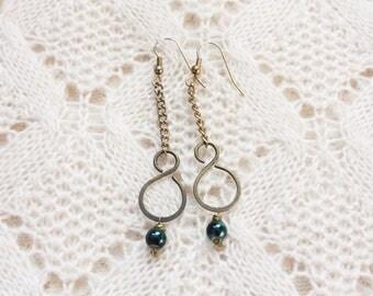 Figure Eight Dangling Earrings | Blue Bead