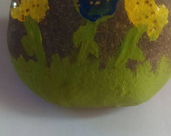 Painted rock with flower design