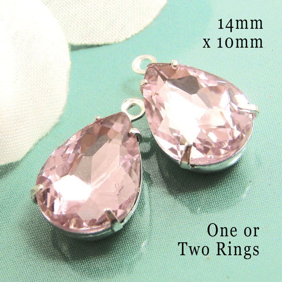 pink glass teardrop beads in silver or brass prong settings... DIY pendants or earring jewels
