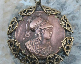 Joan of Arc..the Maid of Orleans rendered in French brass and filigree. A pendant for a strong warrior queen.