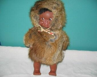 Plastic vintage Eskimo doll with fur coat and hat
