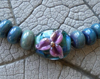 Purple Teal Floral Glass Focal Pair Lampwork Beads by Cherie Sra R114 Flamework Glass Bead Teal encased Purple Flower Focal Pandora Spacers