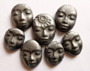 7 matte black ceramic faces