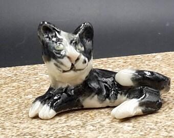Miniature tuxedo cat -  porcelain sculpture