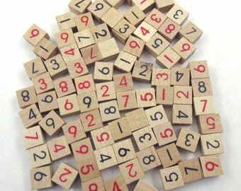 Miniature Wooden Sudoku Tiles or Game Pieces with Black and Red Numbers Set of 85
