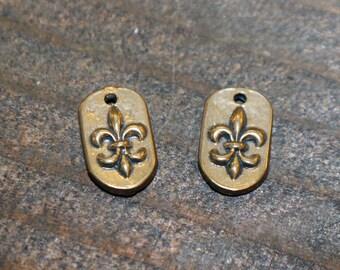 Tiny Oval Fleur De Lis Charms Bronze TWO
