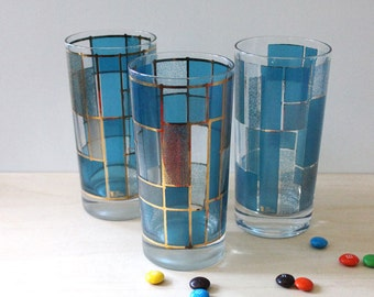 Gold and Blue. Set of three Cera drinking glasses.