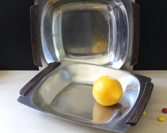 Pair of vintage Selandia Danish modern stainless steel dishes with wooden handles.